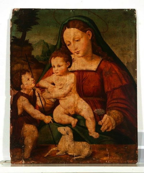 Possibly Mary Magdolene holding the son of her and Christ
