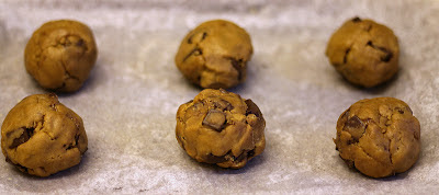 Raw balls of Nutella and hazelnut-stuffed browned butter chocolate chunk cookies