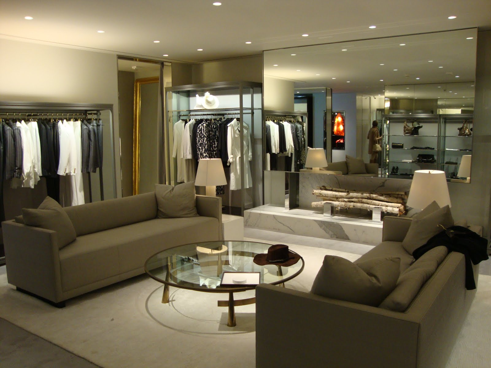 Tom Ford store with fireplace made of mirror & stone