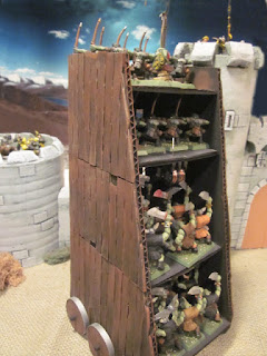Orcs attacking castle with Warhammer Siege Tower