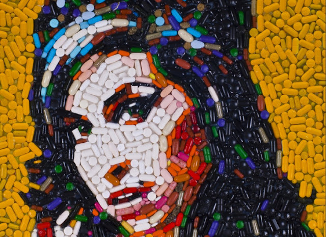 Amy Winehouse portrait made out of 5,000 multi-colored painkillers