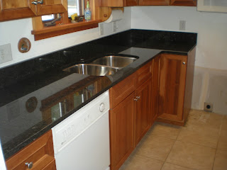 under-mount stainless sink in mesabi black granite countertops