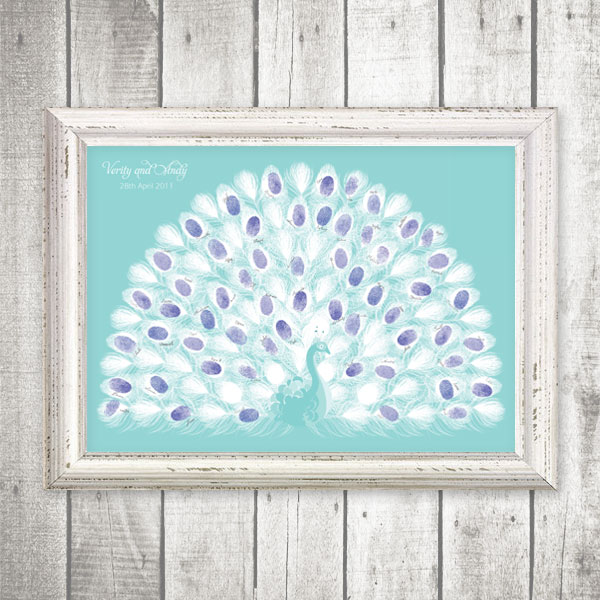 I do it yourself fingerprint peacock guest book you might have come across fingerprint guest books before usually they are trees and the fingerprints form the leaves but weve got a really beautiful solutioingenieria Choice Image