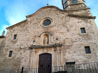 Façana de migdia de l'església parroquial de Sant Bartomeu del Grau