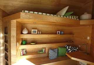 http://webecoist.momtastic.com/2011/12/26/ultra-compact-interior-designs-14-small-space-solutions/