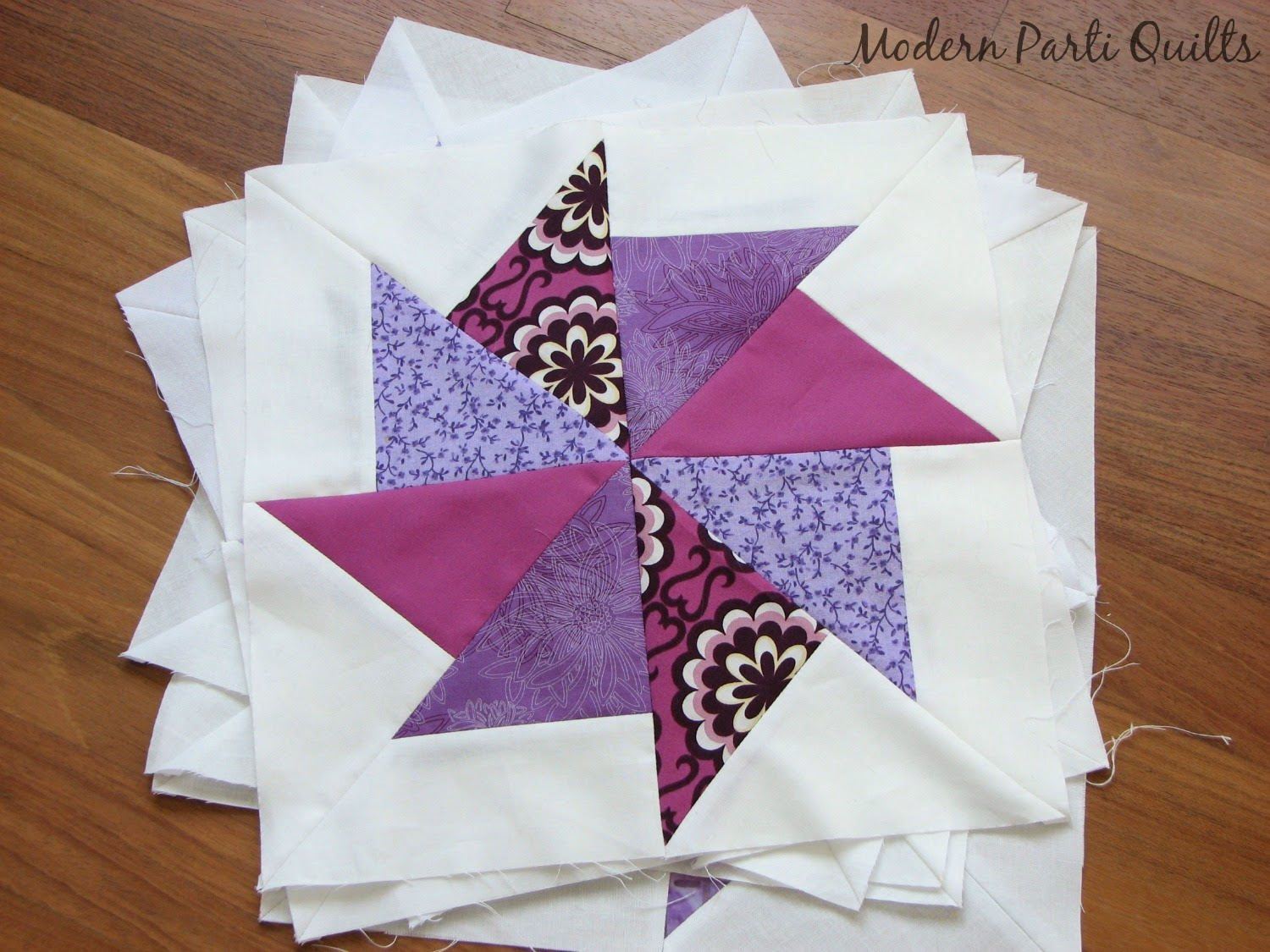 Modern parti quilts purple pinwheel quilt for Modern house quilt block
