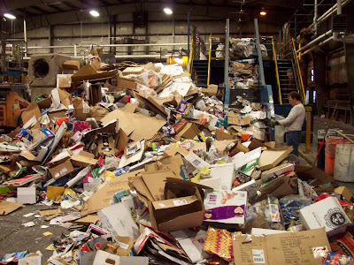 Large pile of paper products in a warehouse