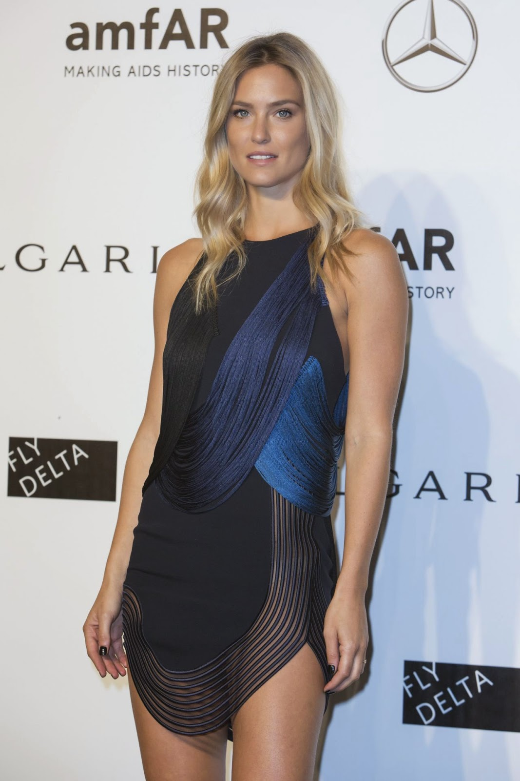 Bar Refaeli wears the Stella McCartey 'Greta' dress to the 2014 amfAR Milano Gala