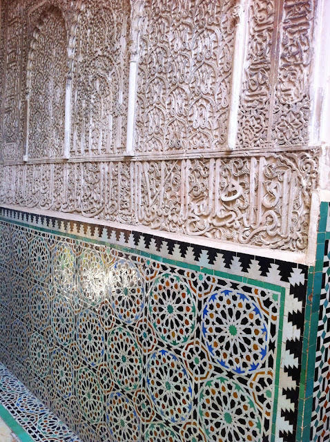 Beautiful wall in Morocco with carvings and tiles