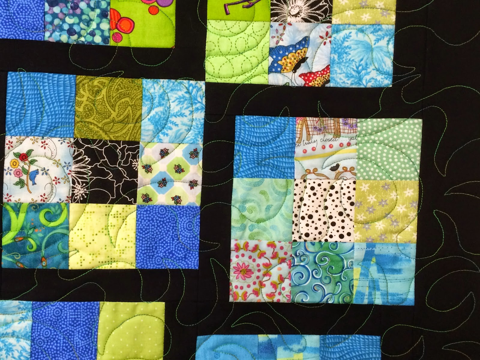 Elizabeth Magee's 9 Patch offset Scrappy Quilt