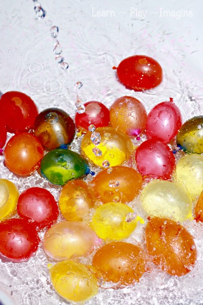 Water balloons in the play pool - beat the heat with simple water play!