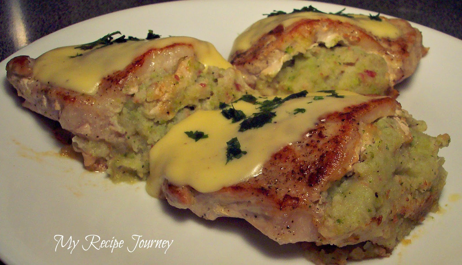 Creamy Vegetable Stuffed Pork Chops Topped with a Light Cheese Sauce