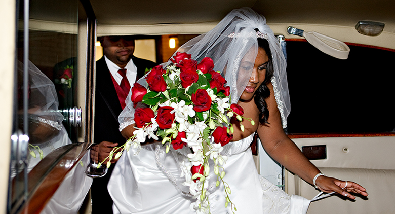Bride entering limo after ceremony
