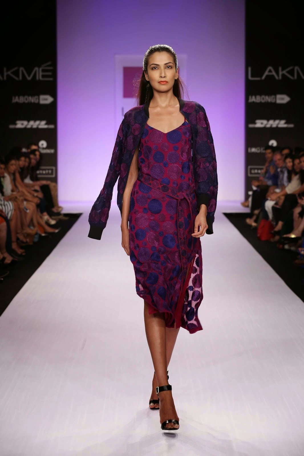 "Anushka Khanna's collection called ""Boom, Boom, Bloom,"" made great fashionable music on the runway at Lakmé Fashion Week Summer/Resort 2014. The designer's inspiration travelled around the globe and halted in New York where the slips, pyjamas, belted kimono jackets and shorts were seen in summer. Moving to studio 54, Anushka's jazzy lamé wrap dresses and sexy maxis reflected the look of that era."