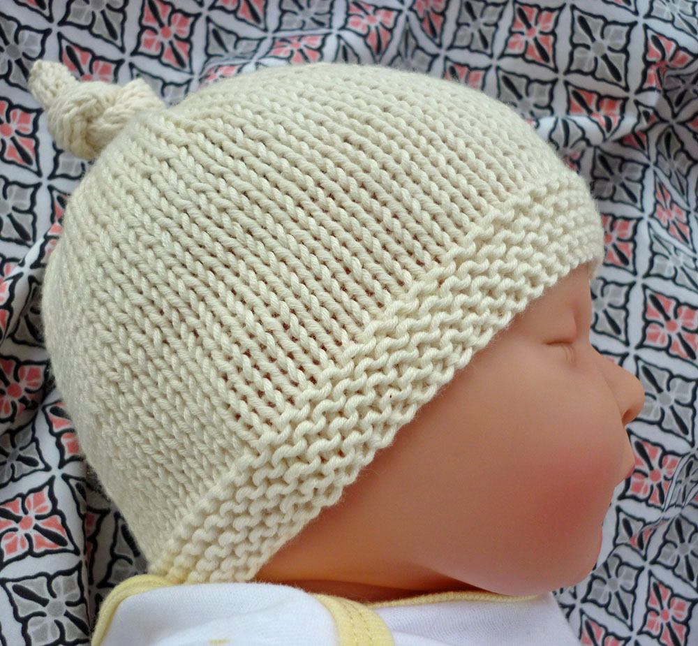 Baby Knitted Hat Patterns On Circular Needles : lovefibres: Tegan - Baby Hat with Top Knot Pattern