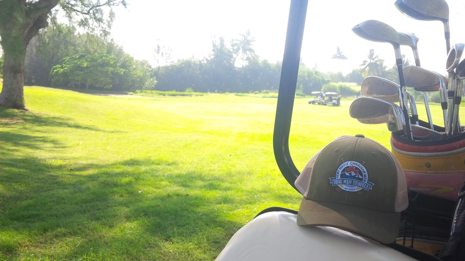 Real Man Travels hat on golf cart