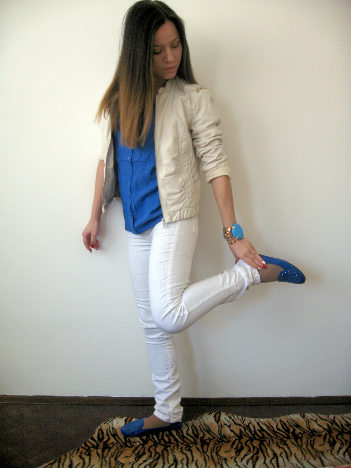 casual outfit, white faux leather jacket, white jeans, white pants, cobalt blue blouse shirt, cobalt blue studded loafers, statement bracelet