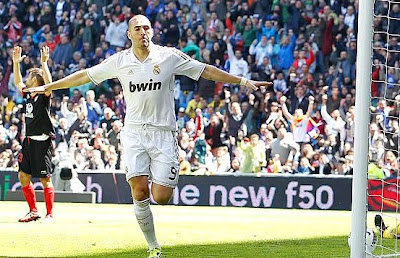 Benzema celebrates a goal against Sevilla