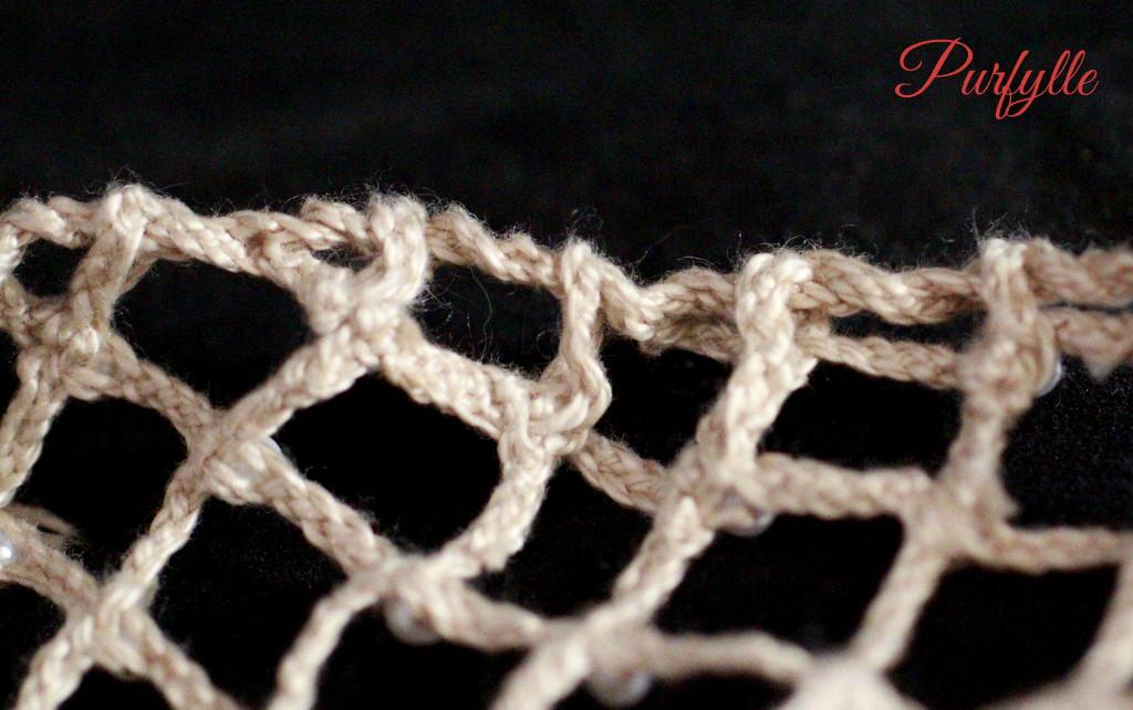 bobbin lace caul ends sewn in