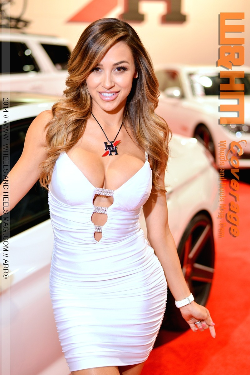 Sema model Ana Cheri for 2Crave Wheels in sexy white dress at 2014 SEMA show