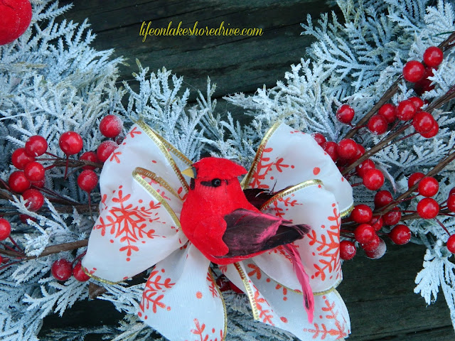 alt=&quot;Winter red and white wreath with cardinals berries and pine cones&quot;