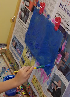 blue easel painting (Brick by Brick)