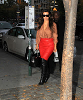 Kim Kardashian arrives at her h