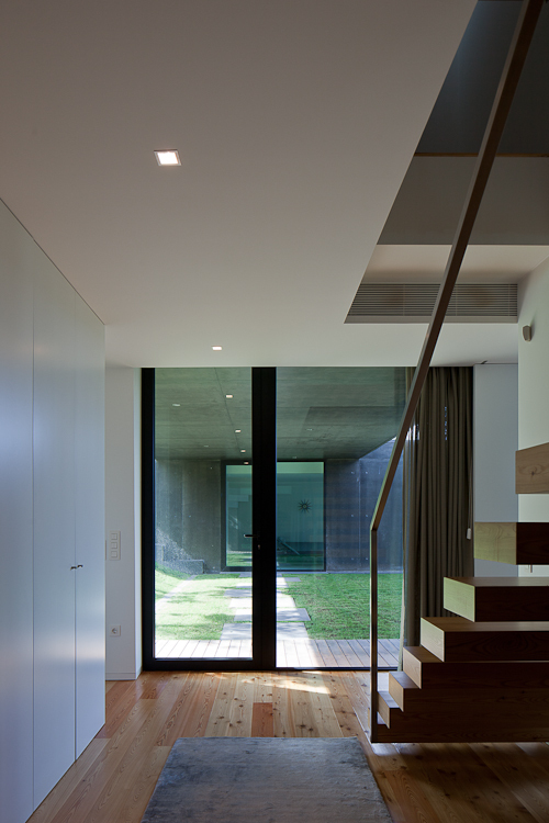 Entrance hallway in Black Concrete House by Pitagoras Arquitectos
