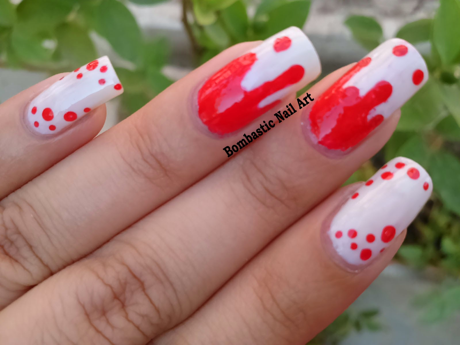 red dripping nails