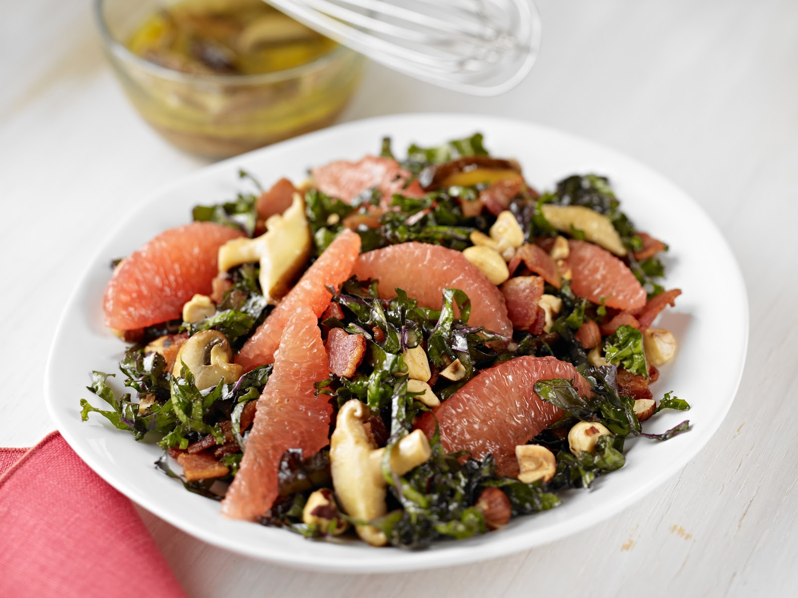 KALE + GRAPEFRUIT SALADWITH WARM BACON-WILD MUSHROOM DRESSING