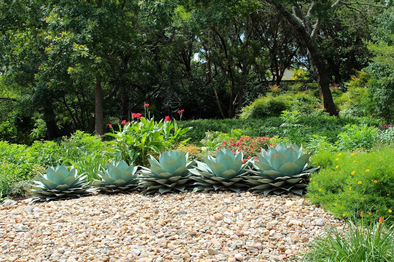 Sharing nature 39 s garden delightful garden tour on a for Sloped rock garden designs