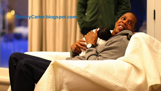 First picture of new daddy Jay Z holding baby Blue Ivy