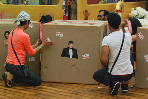 Bigg Boss 7 contestants exploring the boxes for a task
