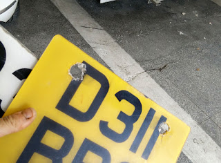 Old number plate hacked out