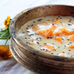 Indian Dessert Mango in Sweet Coconut milk with Black Sesame Seeds spice