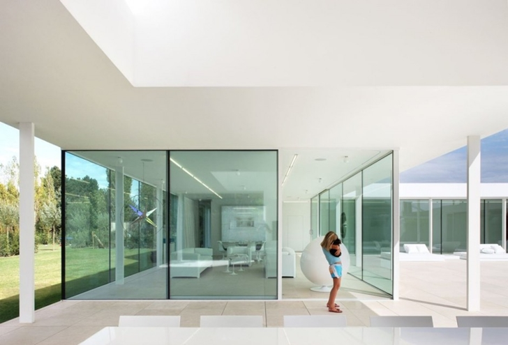 Glass walls of Minimalist Home by Beel & Achtergael Architects