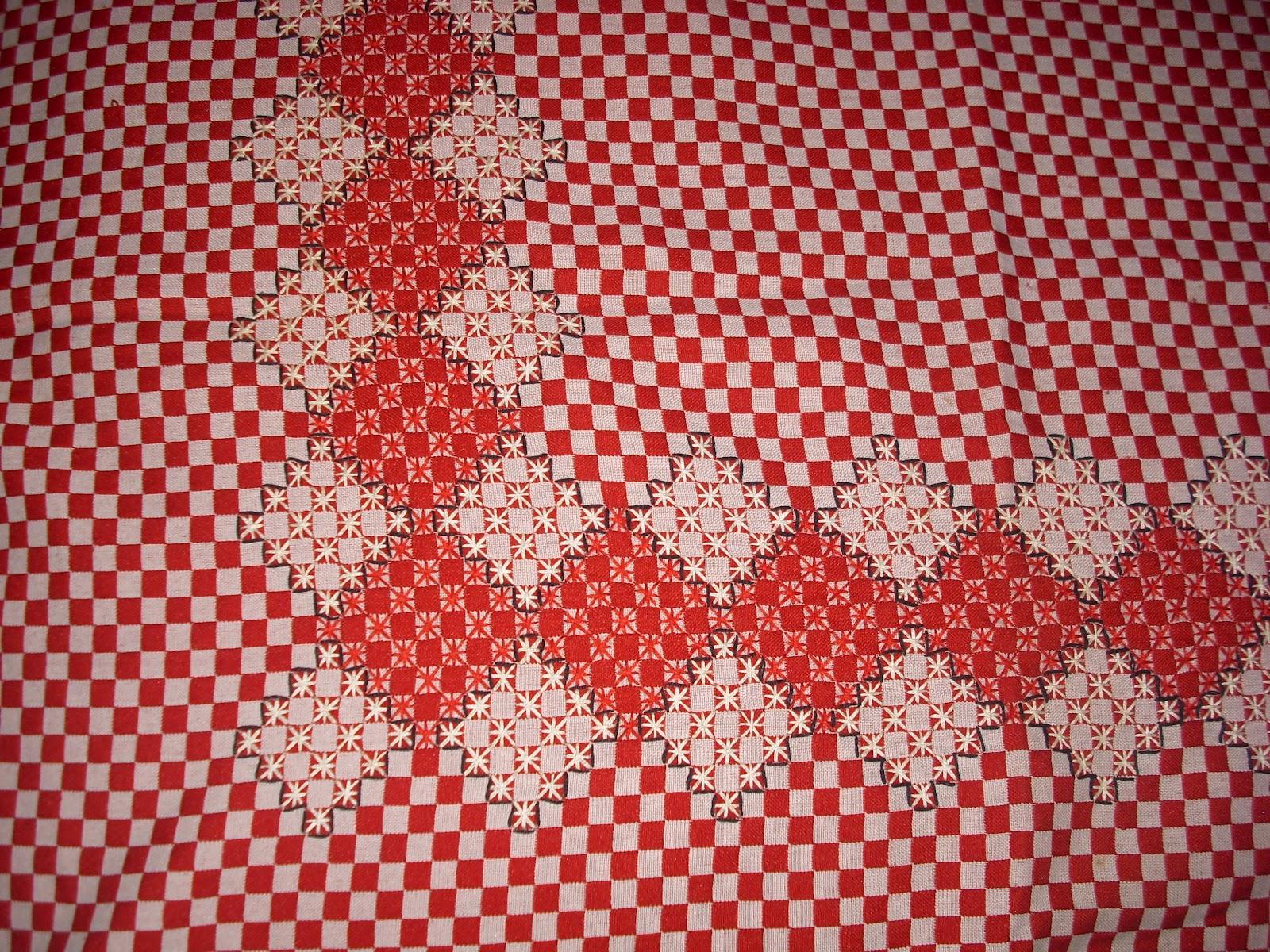 Arañito tejedor: Mantel bordado en punto estrella