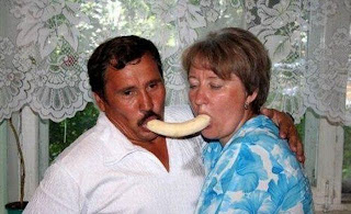 funniest picture Love couple eating together a banana