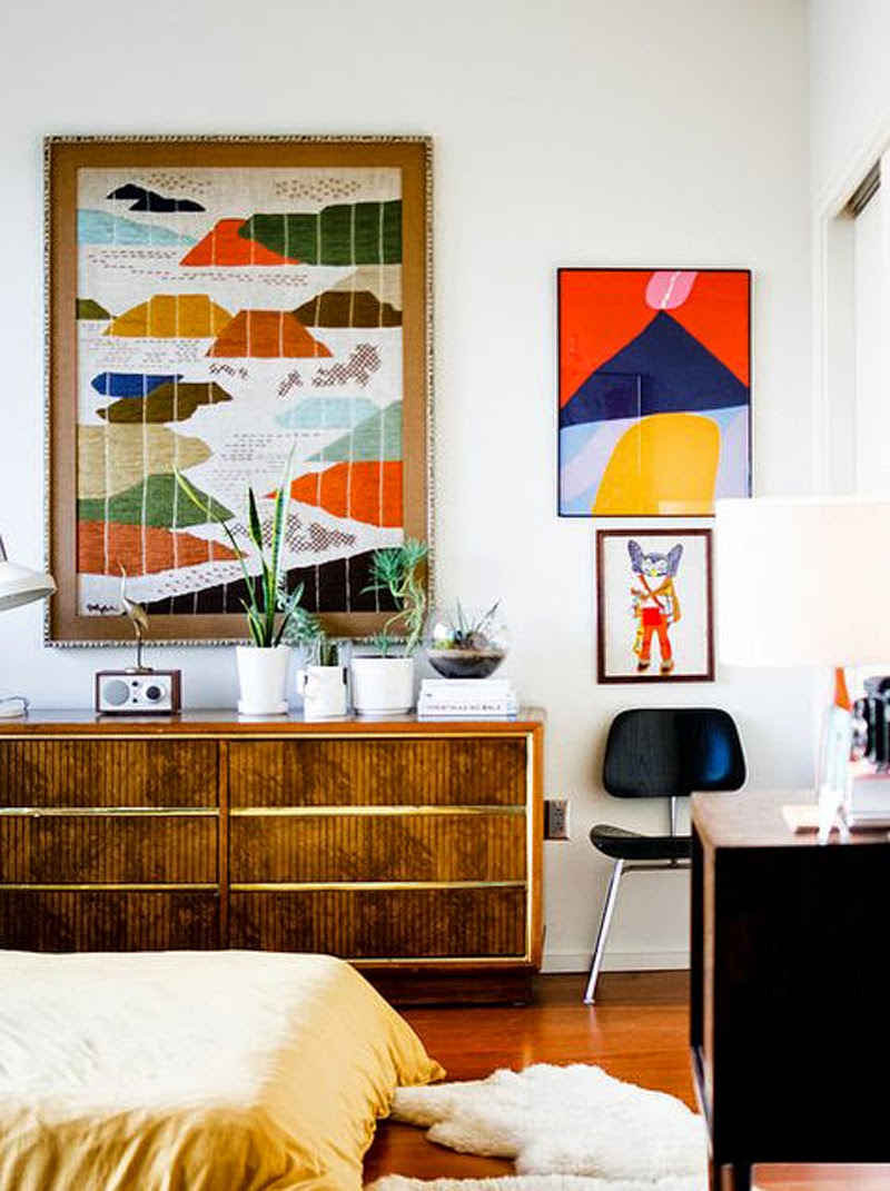 colourful interiors, love the seventies brown against the colour pop prints