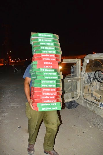 Man carrying many pizza boxxes
