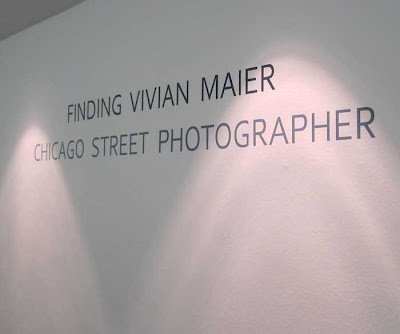 White wall with gray words Finding Vivian Maier: Chicago Street Photographer
