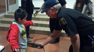 Nine-year old being screened before Tucson school board hearing.