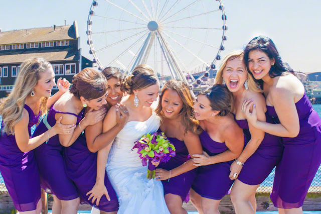 bride and bridal party at the great wheel seattle, ferris wheel wedding photos