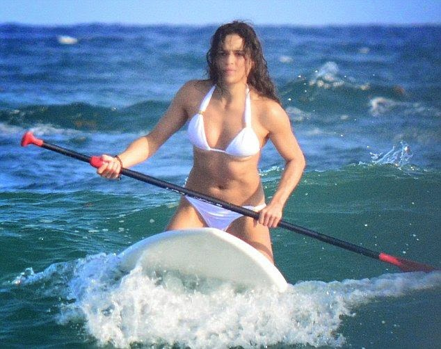There's no doubt about the killer figure and we're sure that Michelle Rodriguez is becoming increasingly to be more focused into our eyes.  Showing off her flawless anatomy in a white string bikini, the 36-year-old riding the waves with paddle boarding at Tulum, Mexico on Tuesday, December 30, 2014.