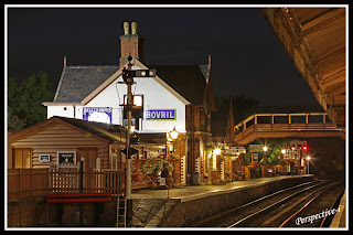 A nightime after dark view of Bewdley Station looking North from the centre platform back towards the station building and footbridge