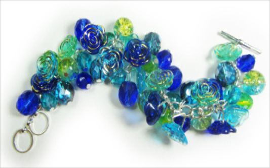 Dramatic bracelet with stunning blue flower buttons and clusters of shiny Czech beads