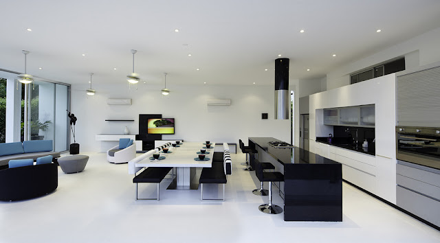Minimalist black and white kitchen and dining room