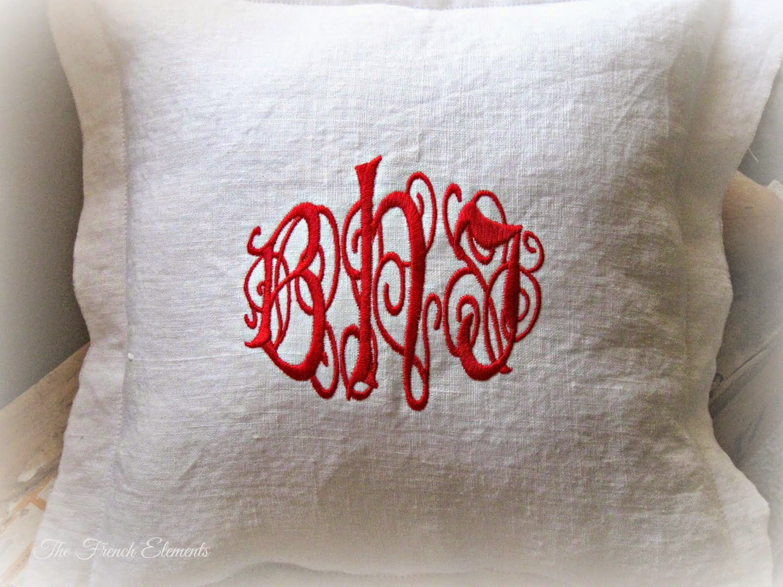 Embroidered monogram linen pillow