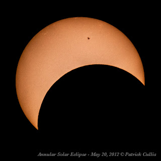 Eclipsing Sun with Sunspot