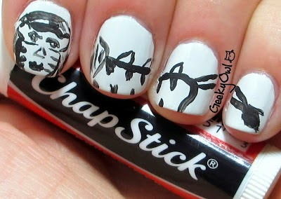 http://www.geekyowl.blogspot.com/2013/04/the-Easy-Nail-Art-does-animal-week_10.html